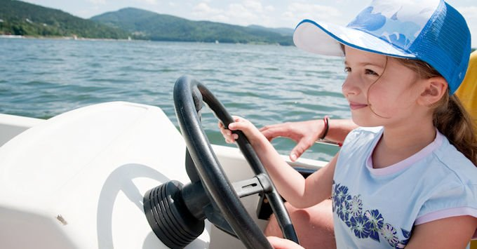 little girl driving boat