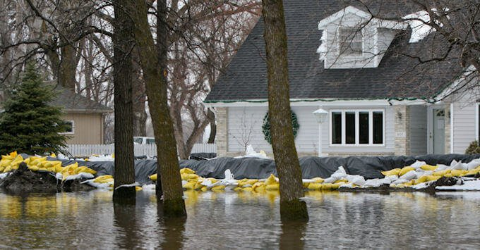 house surrounded by sandbags