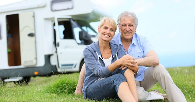 couple in front of rv